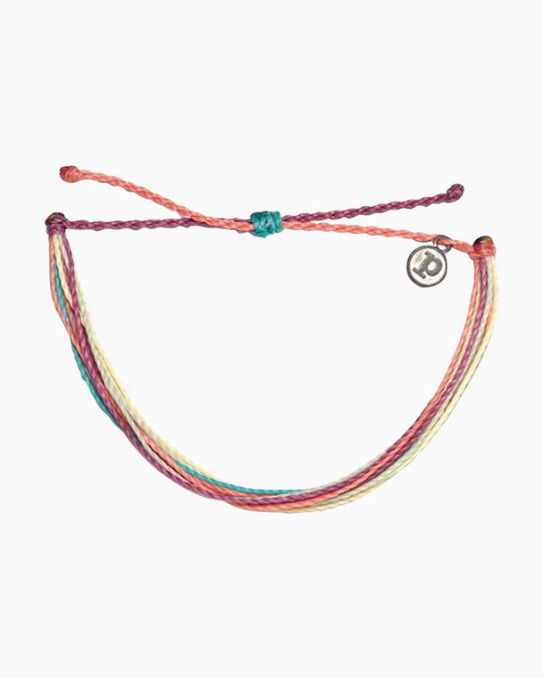 Live a life filled with color, and show your true colors with the Life in Color bracelet from Pura Vida! Made from 100% waterproof cord and so much fun to wear and layer, it can follow you anywhere spring and summer take you - with a little boho flair thrown in!  Adjustable from 2-5 Inches in Diameter Wax-coated cord is 100% waterproof Pura Vida logo charm