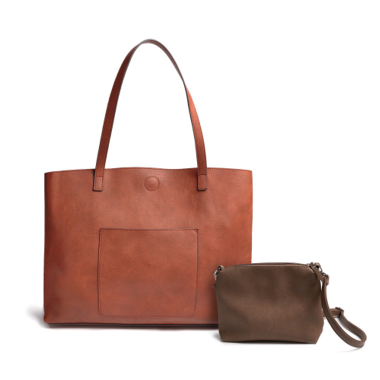 The classic tote with a twist. Perfect to use as a handbag, yet big enough to tote around all of your work essentials. It boasts handles big enough to sit comfortably on your shoulder without a struggle and a roomy front pocket to easily slide your phone or keys in for safe keeping and easy access.  It comes with a crossbody bag inside generous enough in size to be an everyday go to purse. You are going to love this bag so much, you will want it in numerous colors!