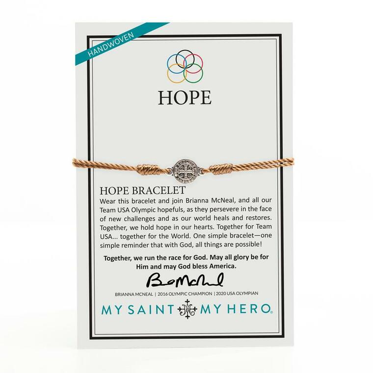 "HOPE   Wear this bracelet and join Brianna McNeal, and all our Team USA Olympic hopefuls, as they persevere in the face of new challenges and as our world heals and restores. Together, we hold hope in our hearts. Together for Team USA... together for the World. One simple bracelet—one simple reminder that with God, all things are possible!  Together, we run the race for God. May all glory be for Him and may God bless America.   BRIANNA MCNEAL | 2016 OLYMPIC CHAMPION | 2020 USA OLYMPIAN  For Men and Women – adjustable cording which opens to 9.5"" diameter Handwoven in Medjugorje, Bosnia and Herzegovina Silver-tone 1 cm Benedictine medal and our logo charm Medals made in Italy On an inspirational card"