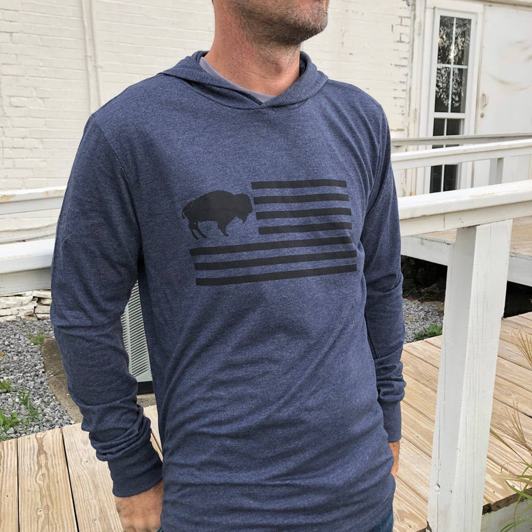 A Unisex design Ladies and Gents will love! You get the best of both worlds in this lightweight long sleeve hooded tee. It is the softest tee material you ever did feel with Rusterior's Iconic Buffalo Flag design on the front. Makes this the perfect hoodie for under your favorite jean jacket. It will easily become your favorite for all seasons!