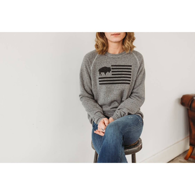 Show your Buffalove with this Triblend Crewneck Sweatshirt that is oh-so-soft. The Unisex design is sized that way too, so ladies, keep your size if you want a cozy oversized fit, size down if you prefer a fitted look. Features Rusterior's iconic Buffalo Flag design on the front.