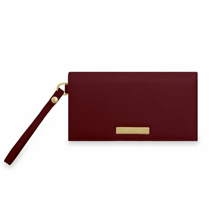 Our chic Cleo wristlet is a little must-have with a lot of style! For the days you need your essentials but don't want a purse to weigh you down, this stone design will take you there in style.  Featuring plenty of card holders, a slip phone compartment and a zipped back pocket, this small but stylish piece will keep you perfectly organised on-the-go. Pop it on your wrist and you'll be ready to take on your next adventure!