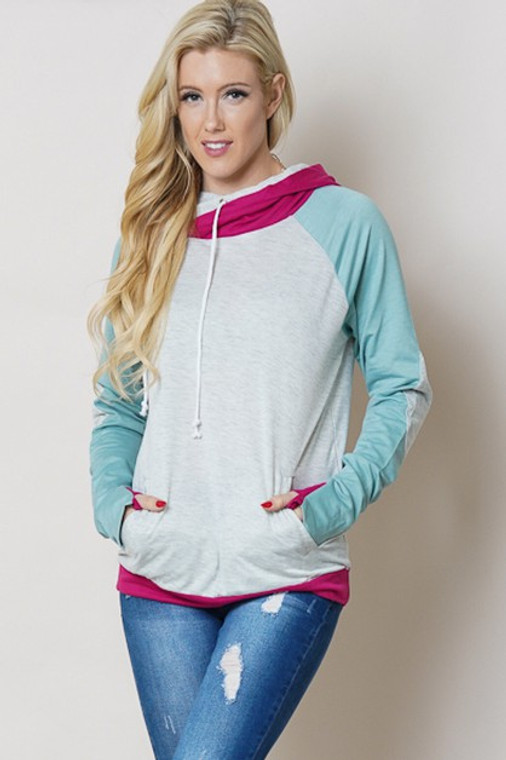 One of our customer favorites! This grey, pink and teal hoodie is a staple in your closet. With the adorable side zip and double hooded detail, it will soon be your favorite too! Light weight fabric makes it a year round fit in your wardrobe.
