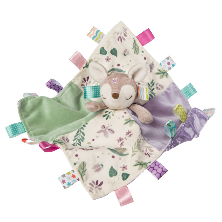 Our little deer is perfect for little dears. Our adorable fawn blanket features 18 Taggies ribbons and a lavender satin liner.  13″ x 13″ 18 Taggies ribbons Neutral tan, lavender, and fern leaves are what's trending Embroidered sleepy eyes and lots of ribbons Lavender colored satin backed blanket Labeled machine wash, air dry