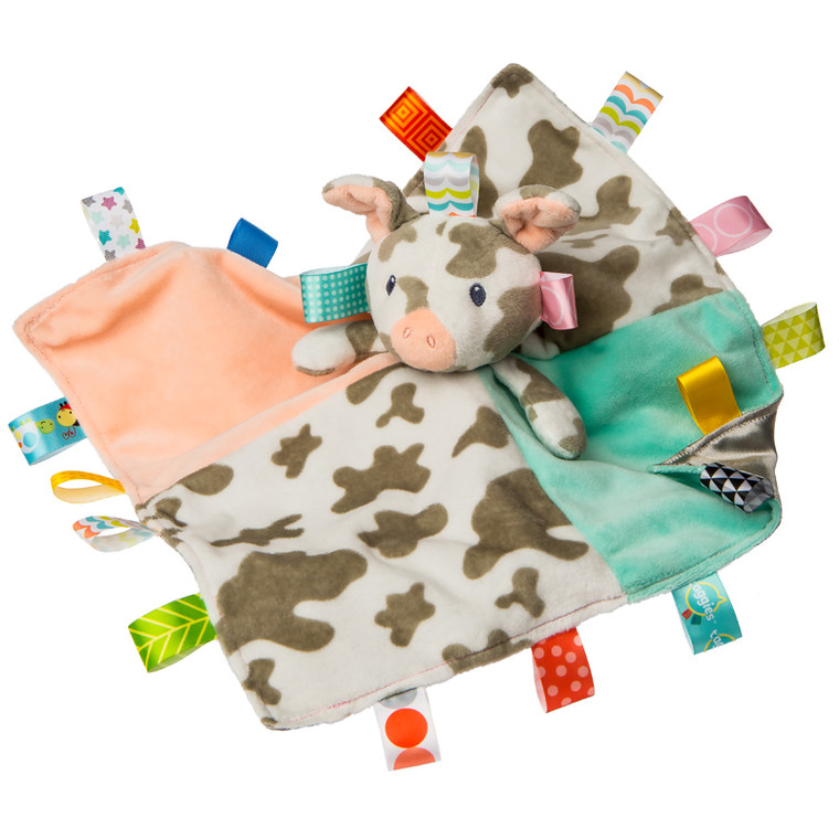 Patches Pig is the latest barnyard friend to join Taggies, and has become a gender neutral favorite. This character shows off it's colorful Taggies ribbons beautifully.Introduced last year, Patches has earned a steady following of Barnyard fans, farm friends always make popular baby gifts!  13″ x 13″ Grey satin lined blanket Lots of Taggies ribbons Embroidered face details Spotted fabric is custom printed and exclusive to Mary Meyer Labeled machine wash, air dry
