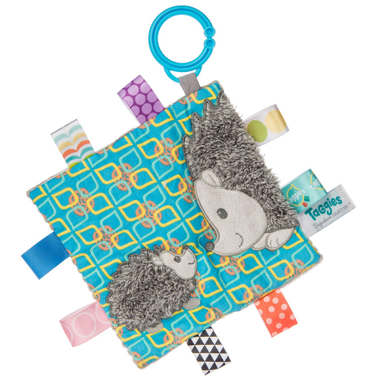 Taggies has gone grey with this gender neutral theme. Two popular woodland critters feature colorful Taggies ribbons and adorable expressions.  Predicted to be a top-seller, just like our long-lasting Buddy Dog. This is the first time grey has been used in combination with the colorful Taggies tags.  6.5″ x 6.5″ Part soother, part activity toy. Coordinates with theHeather & Harley collection. Each Crinkle Me Taggies has fun character appliques and colorful patterns on the outside, crinkle paper and a squeaker on the inside.  Fuzzy, longer pile Upscale look Part soother, part activity toy Crinkle paper and squeaker inside 8 Taggies ribbons Flexible loop for attaching to stroller and crib Labeled machine wash, air dry