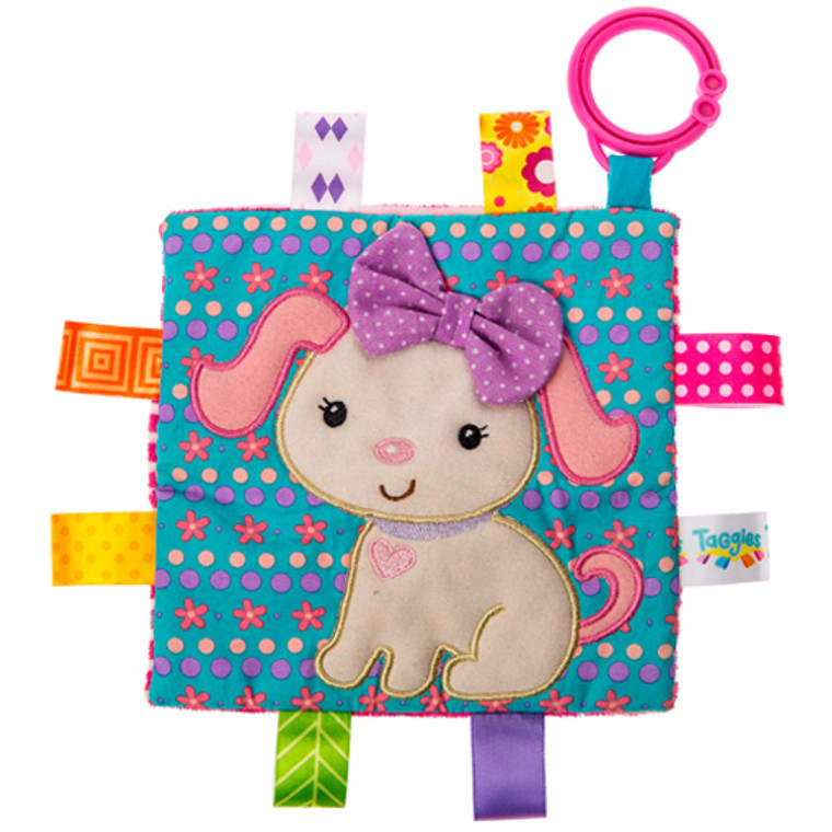 6.5″ x 6.5″ Part soother, part activity toy. Each Crinkle Me Taggies has fun character appliques and colorful patterns on the outside, crinkle paper and a squeaker on the inside. Flexible loop for attaching to stroller and crib. 8 Taggies ribbons. Crinkle paper and squeaker inside. Labeled machine wash, air dry.