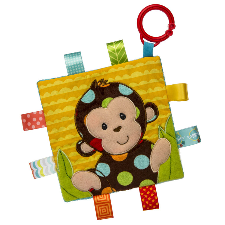 6.5″ x 6.5″ Part soother, part activity toy. Coordinates with the Dazzle Dots Monkey baby mat, soft book, soft toy, blanket, and rattle collection.  Each Crinkle Me Taggies has fun character appliques and colorful patterns on the outside, crinkle paper and a squeaker on the inside. Flexible loop for attaching to stroller and crib. 8 Taggies ribbons. Labeled machine wash, air dry.