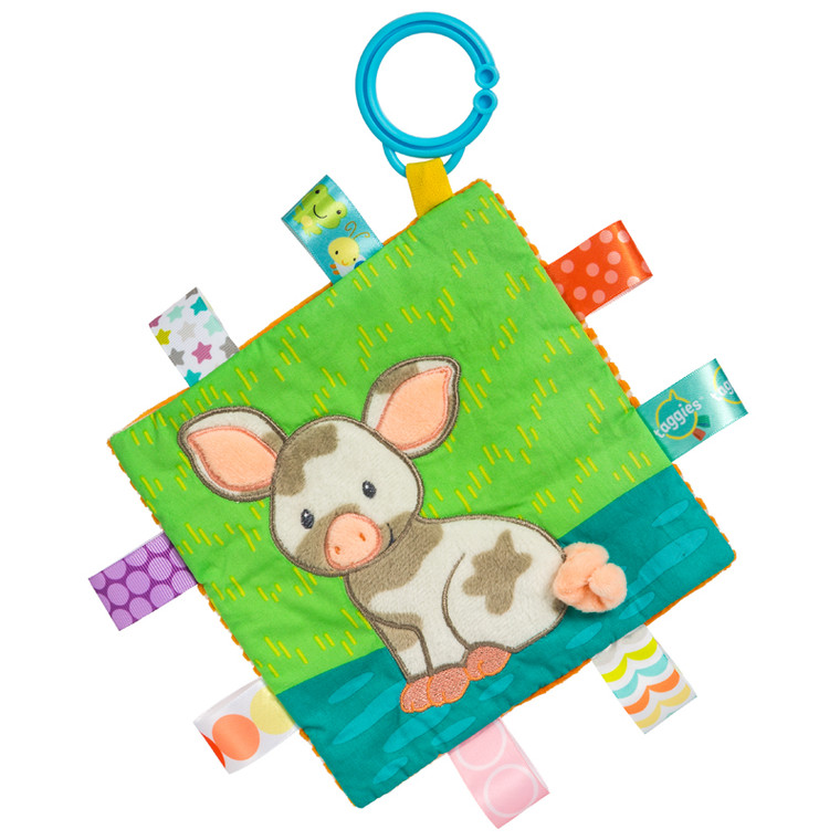 Patches Pig is the latest barnyard friend to join Taggies, and has become a gender neutral favorite. This character shows off it's colorful Taggies ribbons beautifully.Introduced last year, Patches has earned a steady following of Barnyard fans, farm friends always make popular baby gifts!  Each Crinkle Me Taggies has fun character appliques and colorful patterns on the outside, crinkle paper and a squeaker on the inside.  6.5″ x 6.5″ Part soother, part activity toy Embroidered details Crinkle paper and squeaker inside Coordinates with theBarnyard collection 8 Taggies ribbons Flexible loop for attaching to stroller and crib Labeled machine wash, air dry