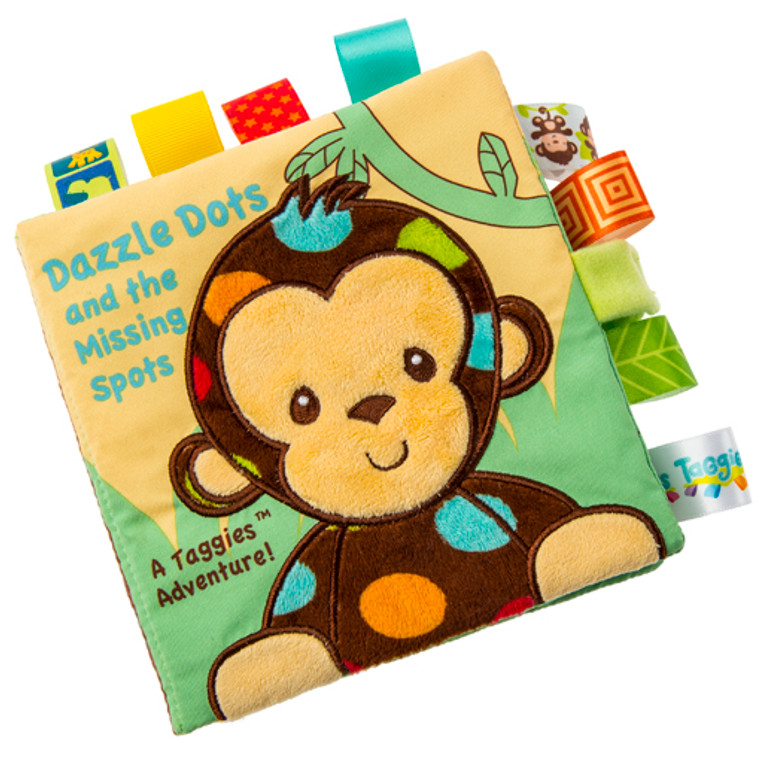 Our most popular Taggies character! He'll dazzle you with his eye catching dots and charm you with his tender, soft touch. Lots of colorful Taggies ribbons throughout.  6″ x 6″ soft book featuring Dazzle Dots Monkey in a story that will bring smiles to both babies and moms. Fabric applique cover. Lots of Taggies-ribbons. 8 pages. Velcro closure. Crinkle paper and squeaker inside. Labeled machine wash, air dry.