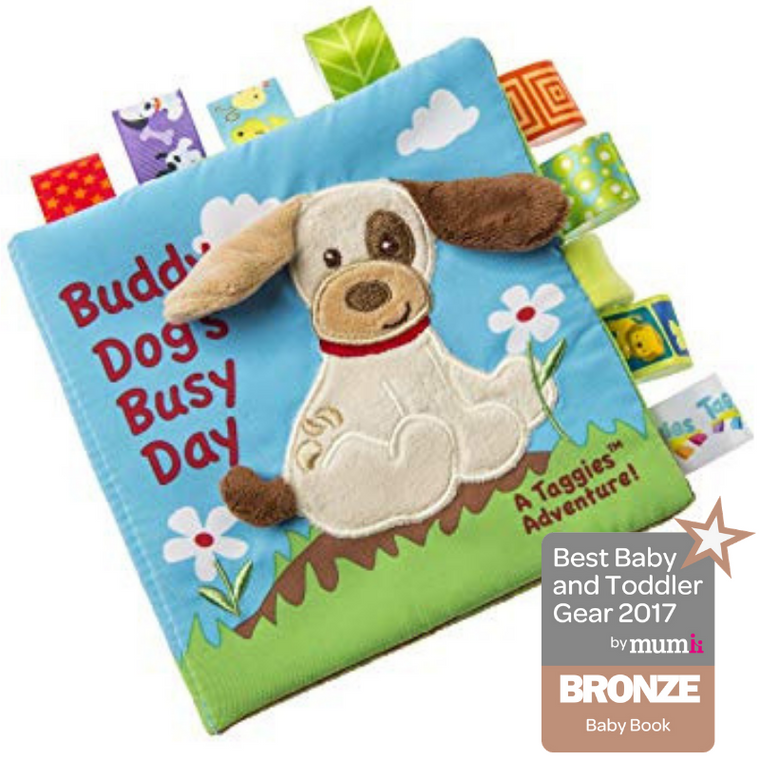 6″ x 6″ soft book featuring Buddy Dog in a story that will bring smiles to both babies and moms. Fabric applique cover. Lots of Taggies-ribbons. 8 pages. Velcro closure. Crinkle paper and squeaker inside. Labeled machine wash, air dry.
