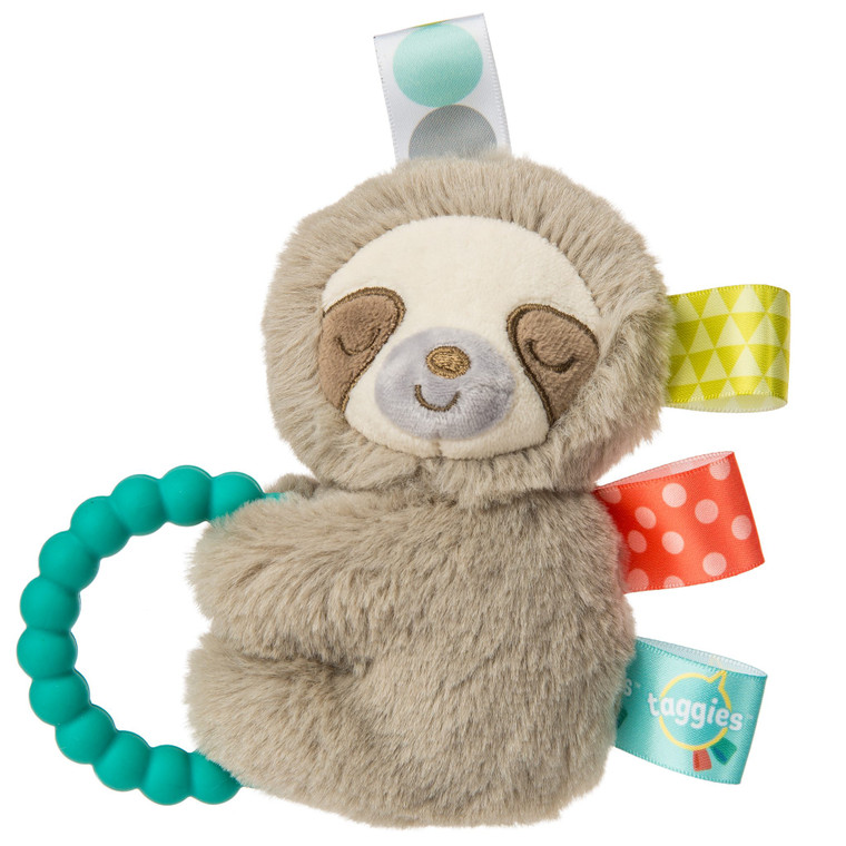 """Finalist for the 2019 Progressive Preschool Awards in the 'Best Infant Development' category  5″ Begin each day with a long, slow hug. In the Baby market, sloths are hot! Molasses is our """"cute"""" version of a realistic sloth. Molasses Sloth is a truly gender neutral buddy. Naturally neutral color palette. Sloth is incredibly soft, with a captivating face, and tags all over. Rattle on the inside and a silicone teether on the outside make this sleepy sloth both stimulating and soothing. Taggies looped ribbons adorn this gender neutral cutie. Machine wash, air dry.  – 5″ – Perfect size and shape for little hands to shake – Neutral tan plush – Embroidered sleepy eyes and lots of ribbons – Rattle inside – Silicone teether ring – Machine wash, air dry"""