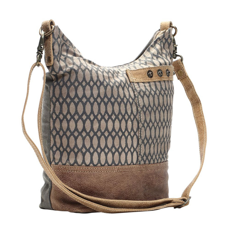 This Shoulder Bag has chic fashion pattern and make traveling in style easy! This bag features one front pocket and zippered top closure to secures items inside. Made of upcycled canvas and leather, this bag is durable adn stylish.