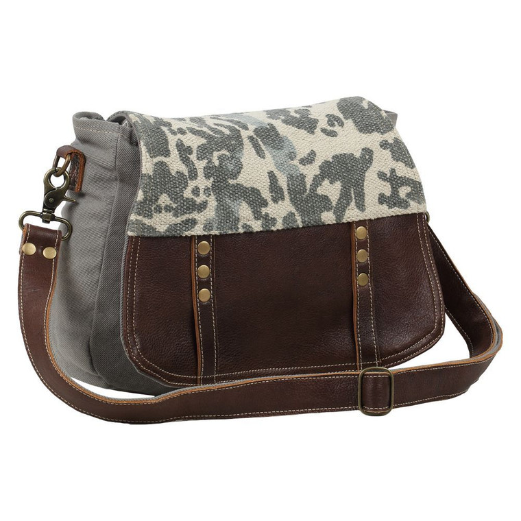 This messenger bag leather and army design canvas bag. Simple design, well sewn craftsmanship. Made from upcycled canvas and leather, this bag is stylish, durable and environmentally friendly.