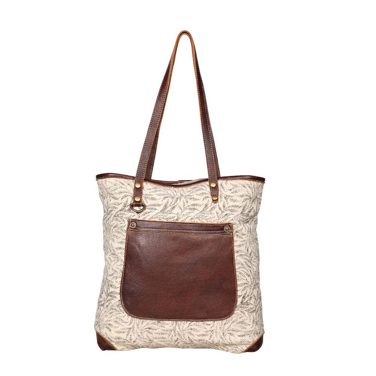This is a stylish tote that has no bottom. Kiddin! It feels bottomless because its huge. Hang it on your shoulders with adjustable leather straps or hold it down, you will anyways look awesome.  Made from upcycled canvas and leather, this bag is stylish, durable and environmentally friendly.