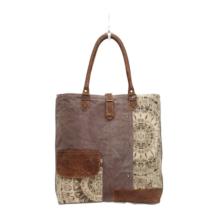 This Canvas tote bag is having beautiful floral design on the front pocket & having a flap over made of genuine leather. Details also feature a buckle over zipper top.  Made from upcycled canvas and leather, this bag is stylish, durable and environmentally friendly.
