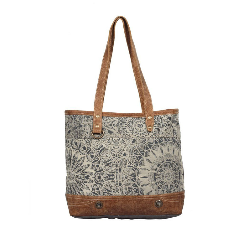 This tote bag has a beautiful design to compliment your style. Made for stylish, practical travellers like you.  Made from upcycled canvas and leather, this bag is stylish, durable and environmentally friendly.