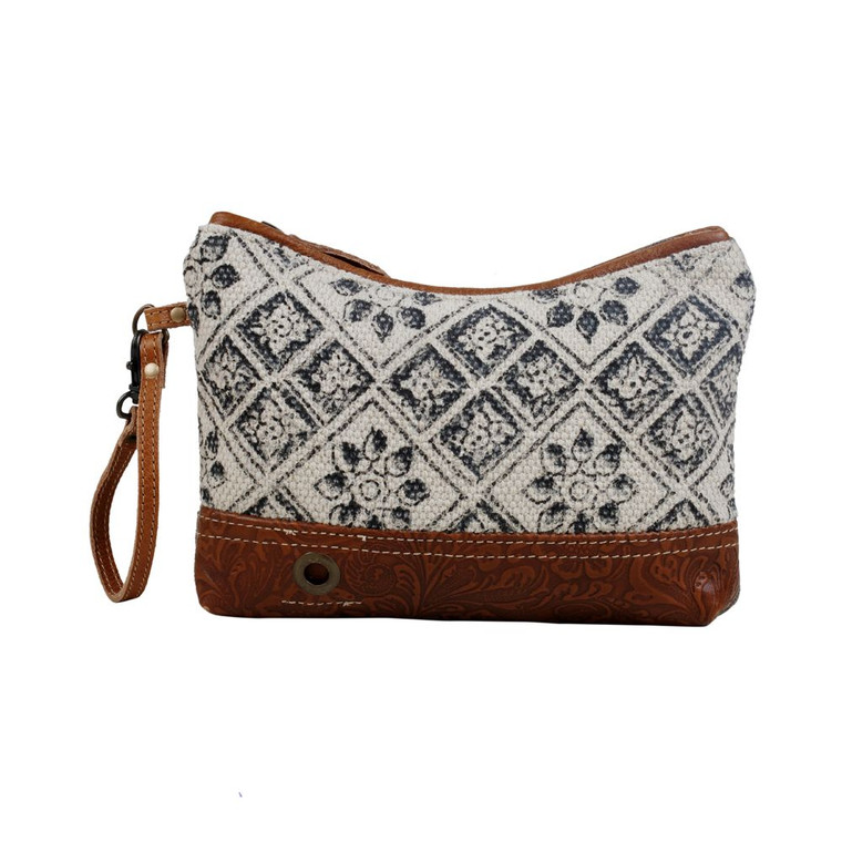 A minimalist pouch with mosaic patchwork which gives it a graceful look. The bottom is supported by embossed leather which makes it resilient and functional for everyday use.  Made of upcycled canvas and leather.