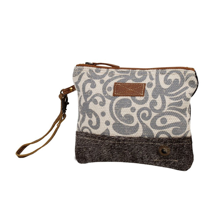 A must-have for everyone to meet their everyday requirements. Zippered top, Hairon bottom, and a wristlet are the three special features of this bag.  Made of upcycled canvas and leather.