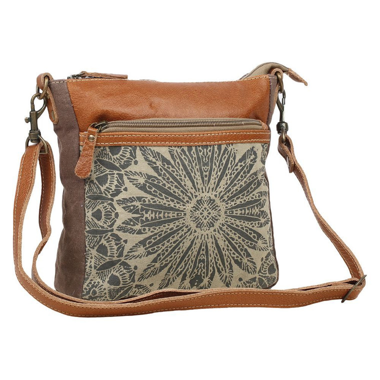 As the name suggests, this bag calls for a perfect adventure. This features one front pocket.  Made of upcycled canvas and leather.