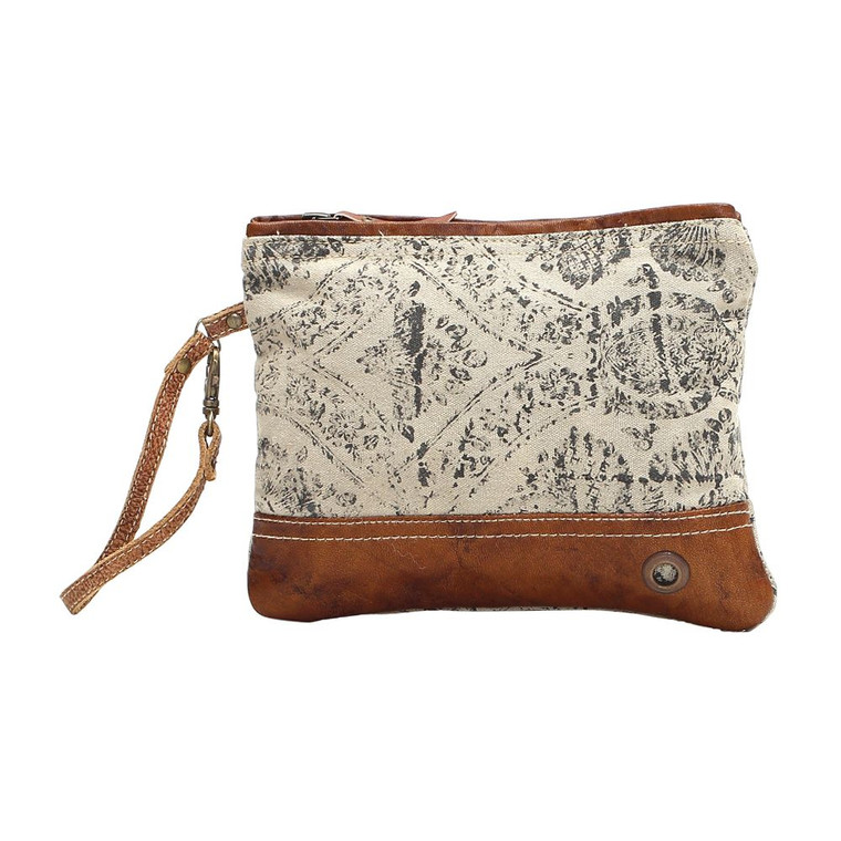 A floralprint pouch that is soothing to the eyes and effient in pupose. The leather strap adds to its personality while the zippers effortlessly hold everything inside.  Made of upcycled canvas and leather.