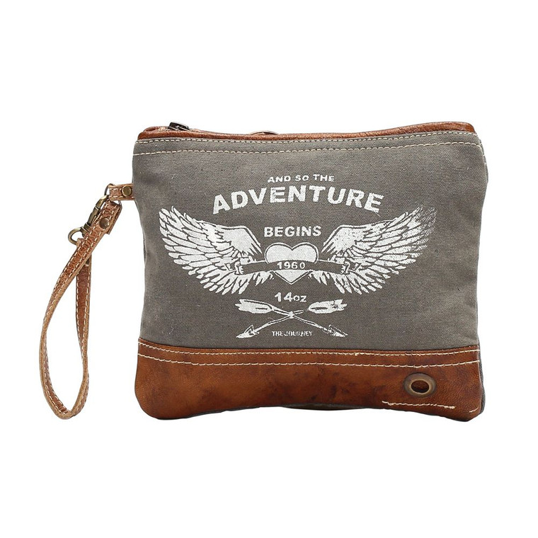 An upcycled canvas pouch that is complimented with wings and adventure begins is pleasing to the eyes and effient in pupose. The leather strap adds to its personality while the zippers effortlessly hold everything inside.  Made of upcycled canvas and leather.