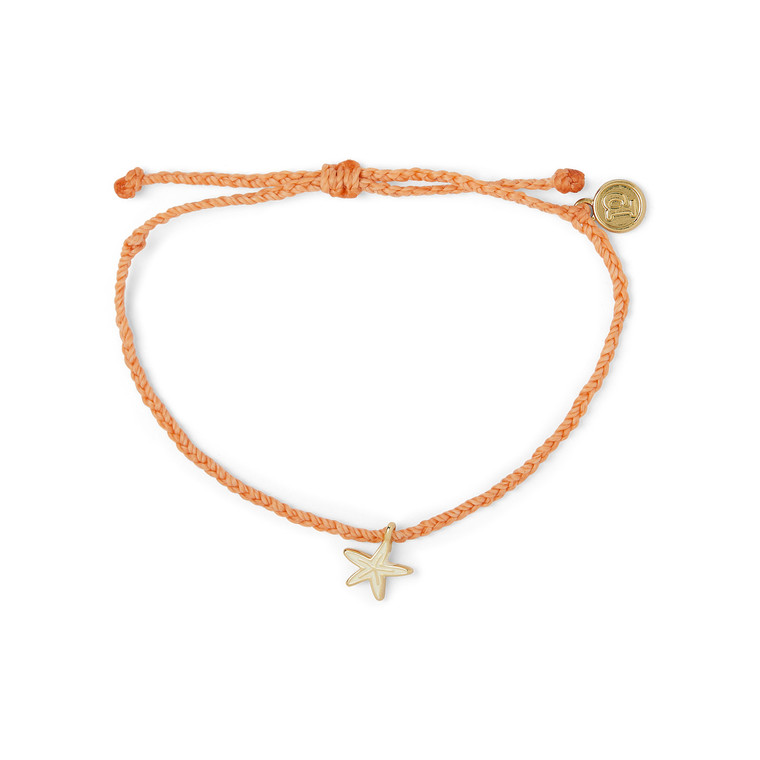 """Accent your wrist with a touch of boho-inspired style courtesy of this super-cute bracelet from Pura Vida! Its braided Coral cord can be worn anywhere, and it's also easily adjustable. Plus, the silver tone starfish charm is decorated with colorful enamel for even more texture and style.  Pura Vida is committed to supporting artisans and charities worldwide, as well as protecting the environment through biodegradable packaging - so you can be sure your beautiful piece of jewelry is doing good for the world!  Gold tone starfish charm and metal """"P"""" charm Adjustable from 2-5 Inches in diameter Waterproof"""