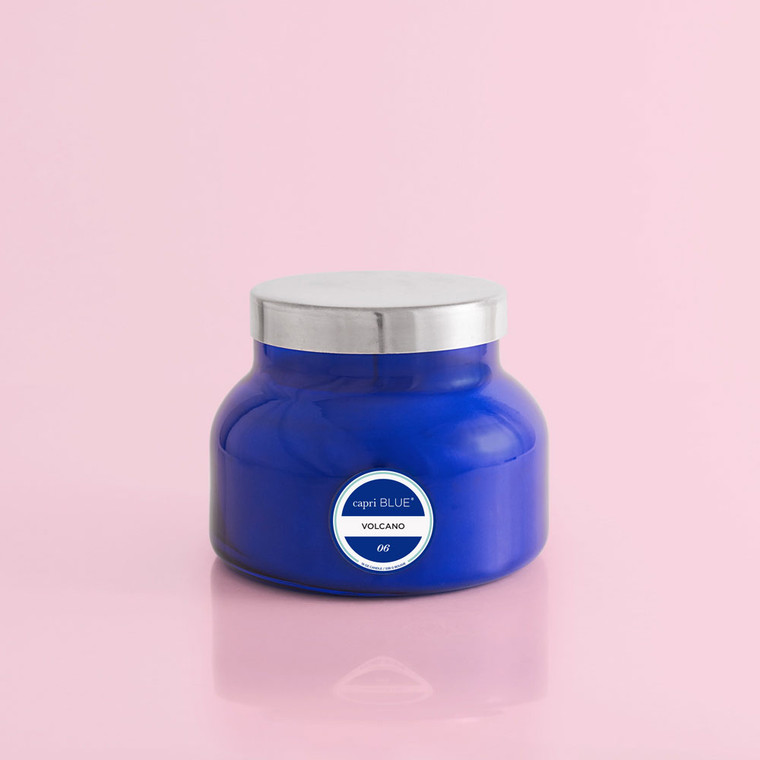 """Capri Blue is built on the stylish back of our famous volcano candle! With its familiar feel and cult following, Volcano is the perfect blend of citrus and sugar notes. Like the excitement and energy of a summer night rendezvous, this fragrance is simply unforgettable.  With its signature silhouette and dynamic cobalt blue look, this Capri Blue classic speaks to its history as a cult favorite.Volcanois an energizing blend of exotic citrus and sugary notes. Feeling like you're in a scented paradise doesn't have to include flying miles away. Fill your space with the enchanting and tropical scent of the unforgettably iconic Volcano candle.  This fashion inspired vessel is sure to turn heads. Just like a subtle pop of color pulls together an outfit this vessel will help complete any space.  Burn Time: Up to 85 hours Dimensions: 4""""h x 5""""d Weight: 19 oz"""