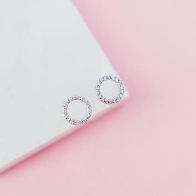 Our Slim Sparkling Circle Earrings are made from solid sterling silver, and feature high quality white cubic zirconia stones. Available in Solid Sterling Silver and Rose Gold Plated.   White Cubic Zirconia Detail Post Backing Nickel Free