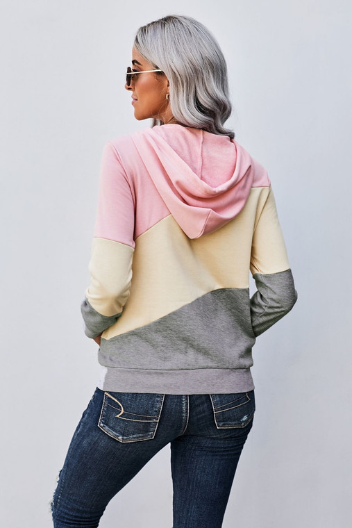 Lightweight, yet cozy materia makes this hoodie a perfect piece for all seasons. Looks great with shorts, jeans and leggings!  •Stylish color block design  •Side pocket design  •Ribbed bottom band and cuffs  Fits true to size for a fitted look. Size up if you want a traditional hoodie fit.