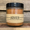 Half cup jar of Advieh spice blend with wood crate background