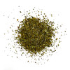 Overhead view of a loose pile of organic Italian Seasoning blend on a white background