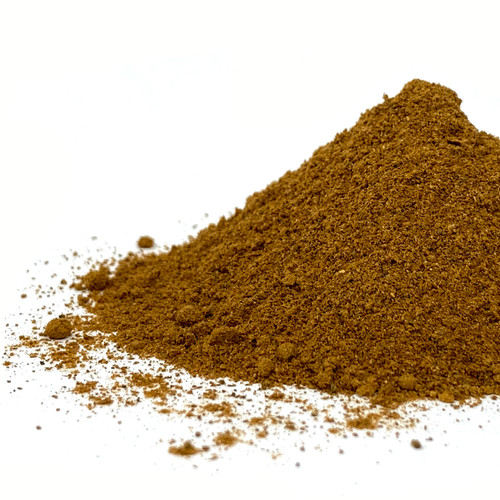 Loose pile of apple spice blend on a white background