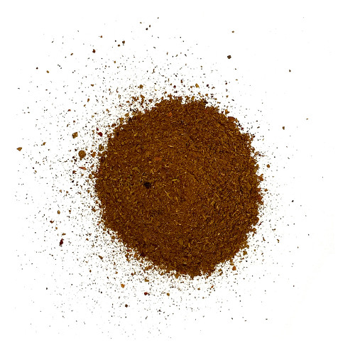 Top view pile of Advieh spice blend on white background