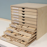 Organize wood mount stamps in craft room drawer cabinet