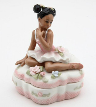 Ballerina on top of Pink Porcelain Box