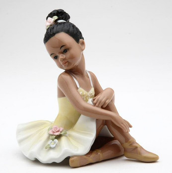 Ballerina Girl Wearing a Yellow Dress Porcelain Sculpture
