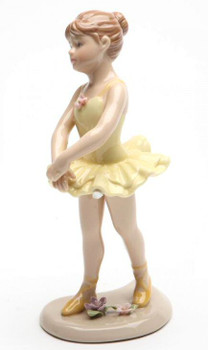 Young Ballerina in Yellow Standing Porcelain Sculpture