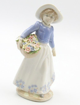 Girl Holding a Flower Basket Porcelain Sculpture by Nadal
