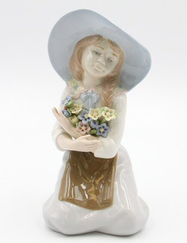 Girl Holding a Bunch of Flowers Porcelain Sculpture by Nadal