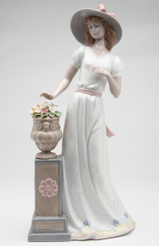 Lady Standing by Flower Pedestal Porcelain Sculpture by Nadal