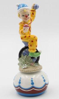 Clown Riding on one Wheel Porcelain Musical Music Box Sculpture