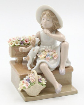 Girl Sitting on a Bench with Her Dog Porcelain Sculpture by Nadal