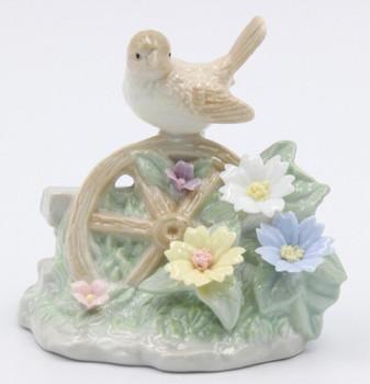 Miniature Wren Bird Sitting on a Wheel Porcelain Sculpture