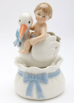 Baby Boy Sitting on a Stork Porcelain Musical Music Box Sculpture