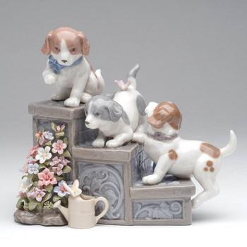 Three Puppies on Garden Steps Musical Music Box Sculpture