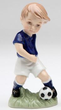 Boy Kicking a Soccer Ball Porcelain Sculpture
