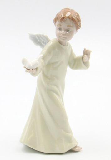 Little Angel Holding A Dove Bird Porcelain Sculpture By