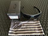 Oakley SI Ballistic Det Cord - Matte Black w/ Tonal USA Flag, Gray Lenses (OO9253-1061)