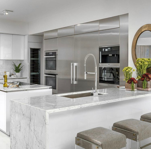 Is Carrara marble good for kitchen countertops?